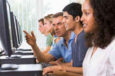 Employees train on their monitors
