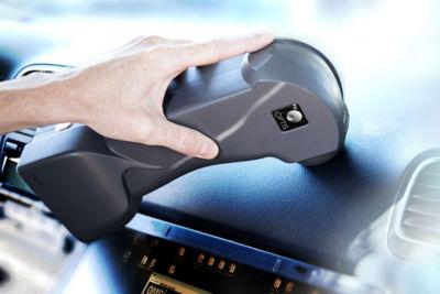 An engineer scans a car dashboard