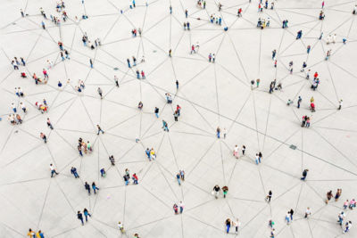Image of people connected representing a network