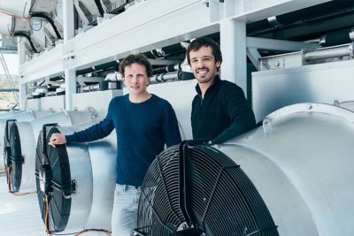 Climeworks founders Christoph Gebald (l) and Jan Wurzbacher in front of the Climeworks plant Copyright Climeworks. Photo by Julia Dunlop
