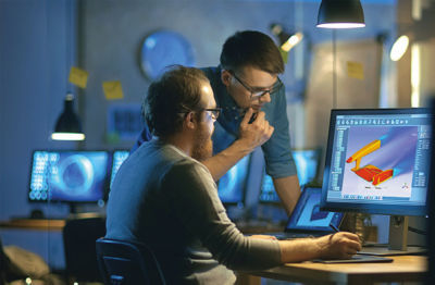 Two men studying a wing simulation