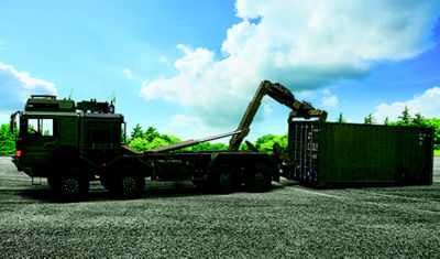 green truck carrying container