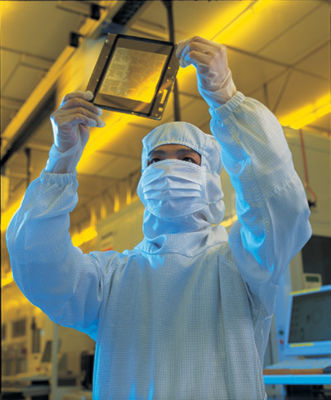 tsmc-fabrication-operator-examining-a-mask-reticle-for-12-inch-wafers.jpg